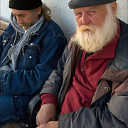 "Two homeless street people of Atlantic City on the boardwalk in November. A.K.A., ""Santa Claus"" looking with distrust at the camera."