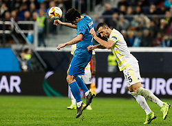 February 21, 2019 - Saint Petersburg, Russia - Sardar Azmoun (L) of FC Zenit Saint Petersburg and Mehmet Topal of Fenerbahce SK vie for the ball during the UEFA Europa League Round of 32 second leg match between FC Zenit Saint Petersburg and Fenerbahce SK on February 21, 2019 at Saint Petersburg Stadium in Saint Petersburg, Russia. (Credit Image: © Mike Kireev/NurPhoto via ZUMA Press)