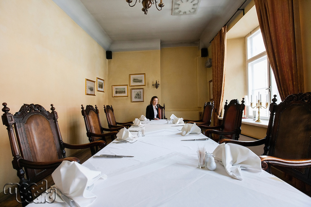 Female customer sitting at dining table in restaurant