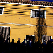 'Attitude at Altitude' Football in Potosi, Bolivia'..Fans make their way home in the late afternoon sunshine after the match between Real Potosi and Wilstermann at The Estadio Victor Agustin Ugarte, Potosi, Bolivia, Real Potosi won the match 3-0. 2nd May 2010. Photo Tim Clayton..'Attitude at Altitude' Football in Potosi, Bolivia'..The Calvario players greet the final whistle with joyous celebration, high fives and bear hugs the players are sprayed with local Potosina beer after a monumental 3-1 victory over arch rivals Galpes S.C. in the Liga Deportiva San Cristobal. The Cup Final, high in the hills over Potosi. Bolivia, is a scene familiar to many small local football leagues around the world, only this time the game isn't played on grass but a rock hard earth pitch amongst gravel and boulders and white lines that are as straight as a witches nose, The hard surface resembles the earth from Cerro Rico the huge mountain that overlooks the town. .. Sitting at 4,090M (13,420 Feet) above sea level the small mining community of Potosi, Bolivia is one of the highest cities in the world by elevation and sits 'sky high' in the hills of the land locked nation. ..Overlooking the city is the infamous mountain, Cerro Rico (rich mountain), a mountain conceived to be made of silver ore. It was the major supplier of silver for the spanish empire and has been mined since 1546, according to records 45,000 tons of pure silver were mined from Cerro Rico between 1556 and 1783, 9000 tons of which went to the Spanish Monarchy. The mountain produced fabulous wealth and became one of the largest and wealthiest cities in Latin America. The Extraordinary riches of Potosi were featured in Maguel de Cervantes famous novel 'Don Quixote'. One theory holds that the mint mark of Potosi, the letters PTSI superimposed on one another is the origin of the dollar sign...Today mainly zinc, lead, tin and small quantities of silver are extracted from the mine by over 100 co operatives and private mining c