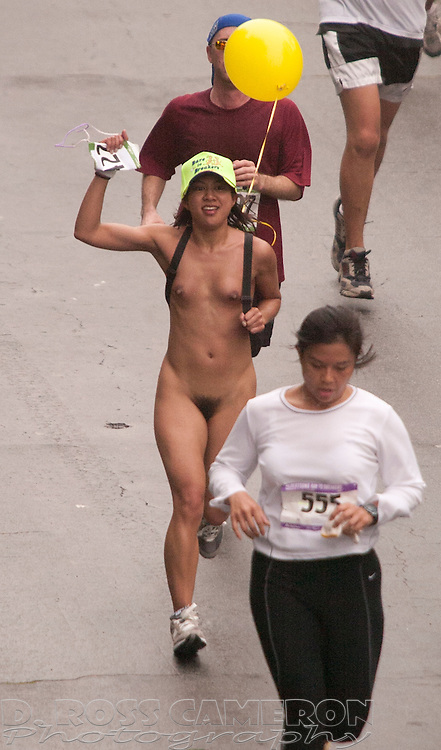 An unidentified naked woman runs with the pack through Golden Gate Park at the 94th running of the Bay to Breakers 12K footrace in San Francisco, Sunday, May 15, 2005. The 7.46-mile race, which attracts upwards of 70,000 participants, is well known for its wacky costumes -- and those who wear nothing at all. (Photo by D. Ross Cameron)