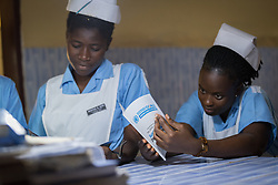 2 November 2019, Ganta, Liberia: Female nurses at Ganta United Methodist Church read about the Sustainable Development Goals. Located in Nimba county, the Ganta United Methodist Hospital serves tens of thousands of patients each year. It is a founding member of the Christian Health Association of Liberia.