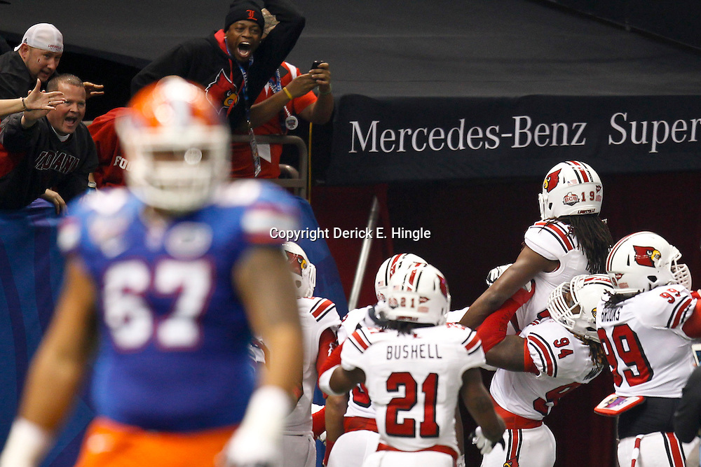 Jan 2, 2013; New Orleans, LA, USA; Louisville Cardinals cornerback Terell Floyd (19) is mobbed by teammates after returning an interception for a touchdown during the first quarter of the Sugar Bowl against the Florida Gators at the Mercedes-Benz Superdome.  Mandatory Credit: Derick E. Hingle-USA TODAY Sports