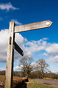 Annandale Way, Lochmaben, Annandale Way walk signpost infront of fields and trees on a sunnny day with blue sky and cloud cover.