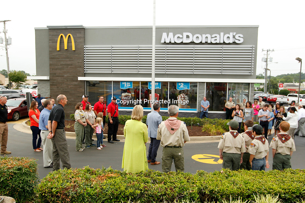 A small crowd attends the ribbon cutting of the remodled McDonald's on Main Street in Tupelo Monday morning.