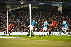 MANCHESTER, ENGLAND - Tuesday, January 19, 2010: Manchester United's Ryan Giggs scores the opening goal against Manchetser United during the Football League Cup Semi-Final 1st Leg at the City of Manchester Stadium. (Photo by David Rawcliffe/Propaganda)