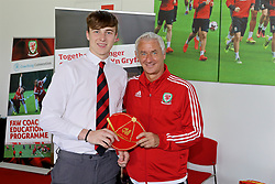 NEWPORT, WALES - Sunday, May 28, 2017: Kieran Davies receives a cap from Elite Performance Director Ian Rush for participation during day three of the Football Association of Wales' National Coaches Conference 2017 at Dragon Park. (Pic by Mark Roberts/Propaganda)