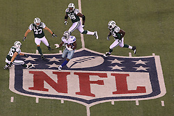 Sept 11, 2011; East Rutherford, NJ, USA;  Dallas Cowboys wide receiver Dez Bryant (88) avoids four New York Jets defenders at mid field during the first half at the MetLife Stadium.