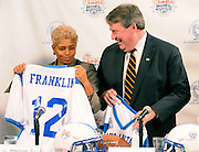 20090924  -  Atlanta, Ga :  Atlanta Mayor Shirley Franklin and National Football Foundation President & CEO Steve Hatchell compare their 2012 football jerseys after it was announced that the College Football Hall of Fame is relocating to Atlanta, at an ESPN Zone ceremony on Thursday, Sept. 24, 2009. The new facility is scheduled to open in 2012 at an as yet to be determined downtown Atlanta location.  The hall is currently in South Bend, Ind. David Tulis         dtulis@gmail.com    ©David Tulis 2009