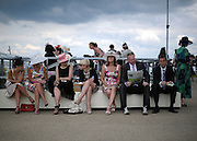 © Licensed to London News Pictures. 19/06/2012. Ascot, UK  Racegoers at Day one at Royal Ascot 19 June 2012. Royal Ascot has established itself as a national institution and the centrepiece of the British social calendar as well as being a stage for the best racehorses in the world.. Photo credit : Stephen Simpson/LNP