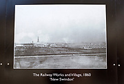 Public display of old historic images about the GWR works, Swindon, Wiltshire, England, UK railway works and village New Swindon 1860