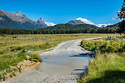 """The Glenorchy-Paradise Road crosses several streams like this in the Dart Valley north of Paradise. We set up a 2-car shuttle to do the Rees-Dart Track. In 5 days, we tramped the strenuous Rees-Dart Track for 39 miles plus 12.5 miles side trip to spectacular Cascade Saddle, in Mount Aspiring National Park, Otago region, South Island of New Zealand. The """"Lord of the Rings"""" (2001, 2002, 2003) film location for Saruman's tower at Isengard was near here, along the Glenorchy-Paradise Road in the Dart Valley."""