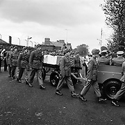 Trooper Ed Gaffney's body is removed..1961..02.10.1961..10.02.1961..2nd October 1961...Trooper Ed Gaffney's mortal remains were removed today from Dublin Airport to Arbour Hill Church. Trooper Gaffney died while on peace keeping duty with the United Nations force in the Congo..Image shows the gun carriage bearing his coffin being escorted to the church in Arbour Hill, Dublin.