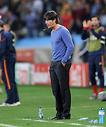 Joachim LOEW (Deutschland) spits after the 2010 FIFA World Cup South Africa Semi Final match between Germany and Spain at Durban Stadium on July 7, 2010 in Durban, South Africa.