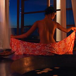 A woman prepares to take a bath in a private luxury villa in Bali, Indonesia.