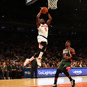 Tim Hardaway Jr. New York Knicks, dunks during the New York Knicks vs Milwaukee Bucks, NBA Basketball game at Madison Square Garden, New York. USA. 15th March 2014. Photo Tim Clayton