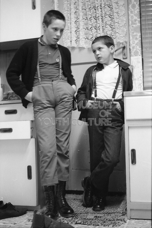 Darren and Alvin in the kitchen, Hawthorne Road, High Wycombe. 1980s.
