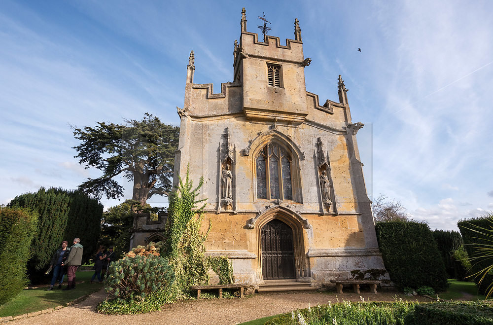© Licensed to London News Pictures. 13/10/2018. Winchcombe, Gloucestershire, UK. Views of the Church of St Mary at Sudeley Castle. Archaeologists from DigVentures hope to unearth a long-lost Tudor garden at Sudeley Castle this weekend. Best-selling historical novelist Dr Philippa Gregory will also be joining the team. Philippa, who's well-known works include The Other Boleyn Girl and The White Queen, started her research into Sudeley Castle whilst working on a novel about Katherine Parr. For nearly 1,000 years, Sudeley Castle has hosted some of England's most famous monarchs including Henry VIII. It is also where Katherine Parr, Henry's last wife, later lived and was finally laid to rest. A recent geophysical survey at Sudeley revealed the ghostly outline of a long-lost Tudor garden, with traces of what could have been a banqueting house in the same area where pieces of Tudor masonry were found in the 19th century. Now experts say it is time to investigate further. The dig will take place at this Saturday and Sunday, October 13 and 14, and is thought to be the most significant archaeological investigation since the discovery of Roman villas on the estate in Victorian times. A specialist team from social archaeology company, DigVentures, will begin an investigation of the site, which aims to 'ground-truth' the geophysics results. They hope to reveal some of the Tudor secrets that remain hidden underground at the castle. Following the popular landscaping movement inspired by Capability Brown, many Tudor gardens were lost, and this is perhaps just one of only two in England where the original paths remain visible. Photo credit: Simon Chapman/LNP