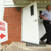 A Tupelo resident walks out of the precinct 10 voting location at Wildwood Baptist Church after casting his vote for the Ward 6 City Council race on Tuesday morning in Tupelo.