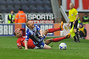 Coventry midfielder Jacob Murphy receives a yellow card for his tackle on Wigan Midfielder David Perkins during the Sky Bet League 1 match between Wigan Athletic and Coventry City at the DW Stadium, Wigan, England on 9 April 2016. Photo by John Marfleet.