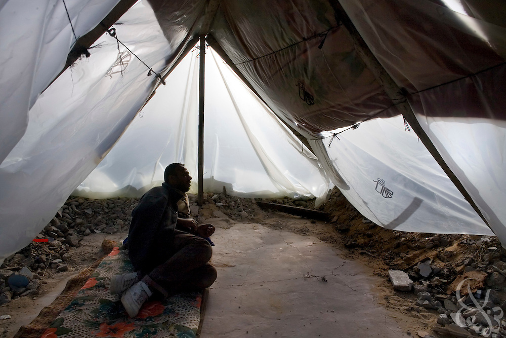 A Palestinian man lies in the tent that is now his home,  January 25, 2009 in the Izbet Abid Rabbo district of Gaza. A week after the end of Israel's 22 day operation against HAMAS in Gaza, Palestinians are struggling to come to terms with their losses and adapt to the massive changes the operation has made on their everyday lives.