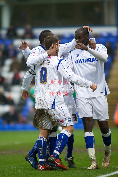PETERBOROUGH, ENGLAND - Saturday, February 19, 2011: Tranmere Rovers'  surround John Welsh (8) after his goal gives his team a 1-0 lead against Peterborough United during the Football League One match at London Road. (Photo by Gareth Davies/Propaganda)