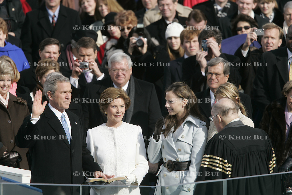 President Bush receives the oath of office from Chief Justice William Rehnquist, right, at the US Capitol in Washington, Jan. 20, 2005. With Bush is first lady Laura Bush, left, and daughters Barbara Bush and Jenna Bush at the 55th Presidential Inauguration...Photo by Khue Bui