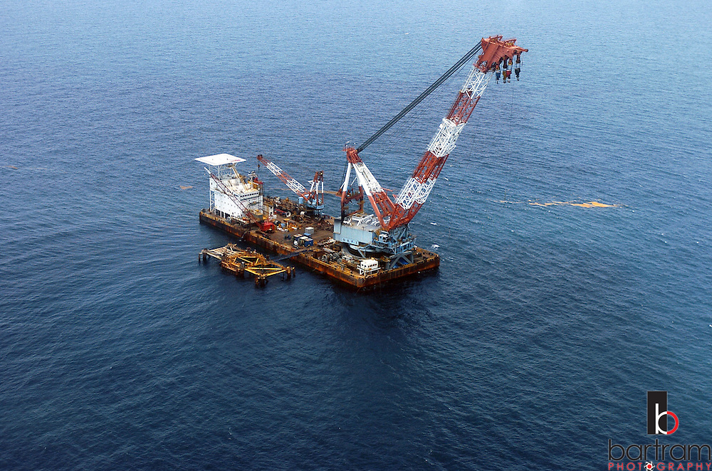 KEVIN BARTRAM/The Daily News.The derrick barge Kallop is anchored next to an abandoned offshore platform on Monday, June 27, 2005. The platform was cut about 90 feet below the surface and the top half lowered to the floor of the Gulf of Mexico to form an artificial reef on Tuesday.