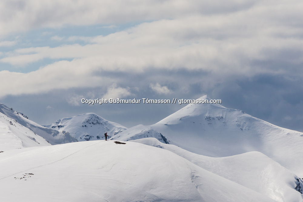 Jökull Bergmann overlooking future ski descents in Hvalvatnsfjörður, Iceland.