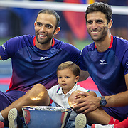 2019 US Open Tennis Tournament- Day Twelve.  Juan Sebastian Cabala and Robert Farah of Colombia and Cabal's two-and-a-half-year-old son, Jacobo, with the winners trophy after their victory in the Men's Doubles Finals match on Arthur Ashe Stadium during the 2019 US Open Tennis Tournament at the USTA Billie Jean King National Tennis Center on September 6th, 2019 in Flushing, Queens, New York City.  (Photo by Tim Clayton/Corbis via Getty Images)