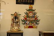 Cai Shen (God of Wealth) and Santa Claus, Snack Street cafe, Wangfujing, Beijing.
