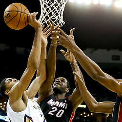 Oct 23, 2013; New Orleans, LA, USA; New Orleans Pelicans power forward Anthony Davis (23) battles for a rebound with Miami Heat center Greg Oden (20) and power forward Chris Bosh (1) during the first half of a preseason game at New Orleans Arena. Mandatory Credit: Derick E. Hingle-USA TODAY Sports