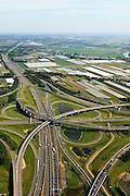 Nederland, Zuid-Holland, Ridderkerk, 23-05-2011; Knooppunt Ridderkerk, verkeersknooppunt A15 / A16, bijgenaamd 'Ridderster'. Gezien naar het zuiden, richting Breda. Klaverblad met opritten, afritten en fly-overs. De waterpartijen zijn kunstmatige aangelegd en kunnen dienen als bluswater ingeval calamiteiten.<br /> Ridderkerk junction, junction A15 / A16, nicknamed 'Ridder star'.  Cloverleaf type junction, with ramps, exit ramps and flyovers. The ponds are man-made and the water can be used for  firefighting in case of emergencies.<br /> luchtfoto (toeslag), aerial photo (additional fee required)<br /> copyright foto/photo Siebe Swart