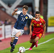 Scotland's Ryan Christie goes past FYR Macedonia's Mevlan Murati during Scotland Under-21 v FYR Macedonia,  UEFA Under 21 championship qualifier  at Tynecastle, Edinburgh. Photo: David Young<br /> <br />  - © David Young - www.davidyoungphoto.co.uk - email: davidyoungphoto@gmail.com