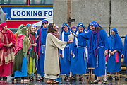 The washing of the feet with expensive oil - The Wintershall Players open-air re-enactment of 'The Passion of Jesus' on Good Friday in the rain in Trafalgar Square. It featured a cast of over 100 volunteers from in and around London.