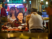 """27 DECEMBER 2016 - SINGAPORE:  Tiong Bahru Market in Singapore is popular with local people who live in the community and expatriots living in Singapore. Market vendors sell a lot of imported foodstuffs and the food """"hawker"""" area is one of the most popular in the city.      PHOTO BY JACK KURTZ"""