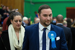 © Licensed to London News Pictures . 13/12/2019. Bury, UK. CHRISTIAN WAKEFORD Conservative candidate for Bury South , arrives with his wife at the count for seats in the constituencies of Bury North and Bury South in the 2019 UK General Election , at Castle Leisure Centre in Bury . Photo credit: Joel Goodman/LNP