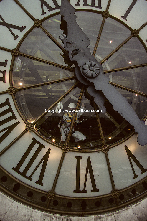 Man Cleaning Musee d'Orsay Clock