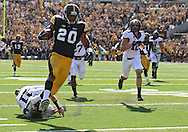 September 29 2012: Iowa Hawkeyes linebacker Christian Kirksey (20) pulls away from Minnesota Golden Gophers quarterback Max Shortell (11) while returning an interception 68 yards for a touchdown during the fourth quarter of the NCAA football game between the Minnesota Golden Gophers and the Iowa Hawkeyes at Kinnick Stadium in Iowa City, Iowa on Saturday September 29, 2012. Iowa defeated Minnesota 31-13 to claim the Floyd of Rosedale Trophy.