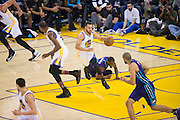 Golden State Warriors guard Stephen Curry (30) pushes the ball down the court against the Charlotte Hornets at Oracle Arena in Oakland, Calif., on February 1, 2017. (Stan Olszewski/Special to S.F. Examiner)
