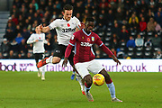 Aston Villa defender Axel Tuanzebe (4) shields the ball from Derby County forward Jack Marriott (14) during the EFL Sky Bet Championship match between Derby County and Aston Villa at the Pride Park, Derby, England on 10 November 2018.