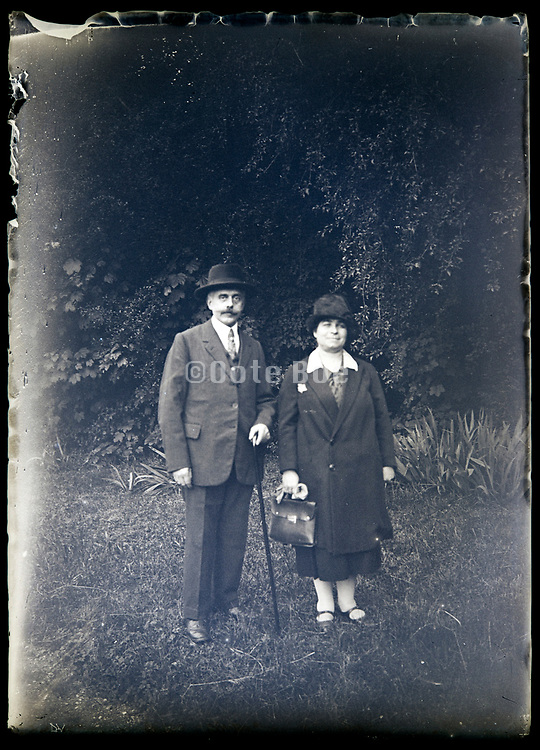 elderly couple in nature setting France circa 1930s
