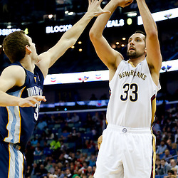 Dec 13, 2013; New Orleans, LA, USA; New Orleans Pelicans power forward Ryan Anderson (33) shoots over Memphis Grizzlies power forward Jon Leuer (30) during the first quarter of a game at New Orleans Arena. Mandatory Credit: Derick E. Hingle-USA TODAY Sports