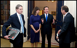 Cabinet Secretary Sir Gus O'Donnell (right) watches the The Prime Minister David Cameron arrive inside the Cabinet room for the first at No10 as the new PM, Tuesday May 11, 2010. with Cabinet Secretary Sir Gus O'Donnell and  Jeremy Heywood (left, Folders) currently Permanent Secretary at No. 10..The  Cabinet Secretary Sir Gus O'Donnell steps down at the end of the year and is replaced by Jeremy Heywood (left), currently Permanent Secretary at No. 10, will replace Gus O'Donnell as Cabinet Secretary. Photo By Andrew Parsons/ i-Images