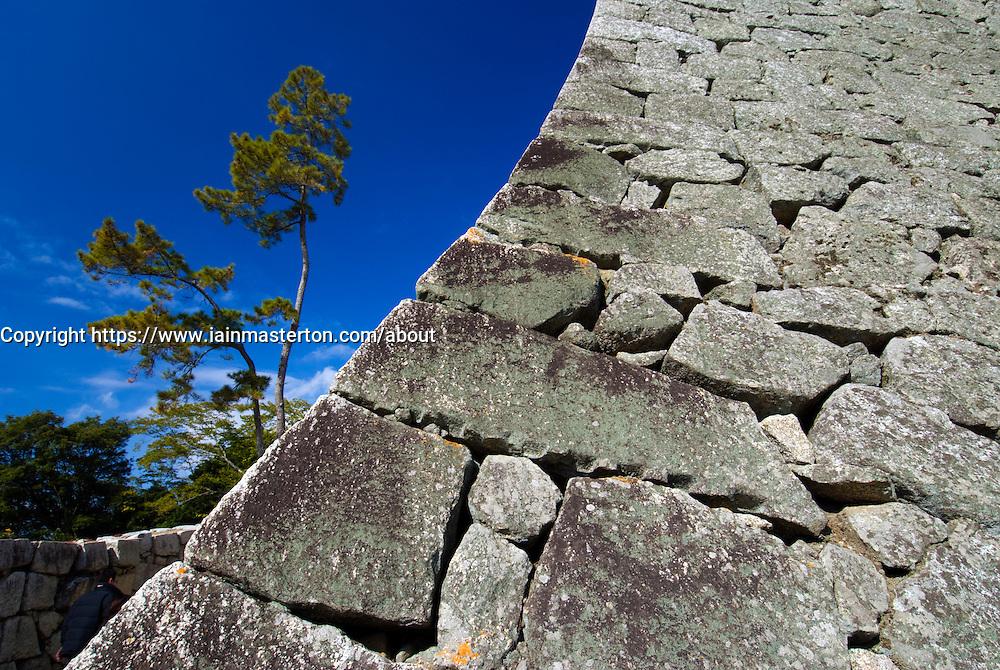 Detail of old stone walls of Matsuyama Castle in Shikoku Japan