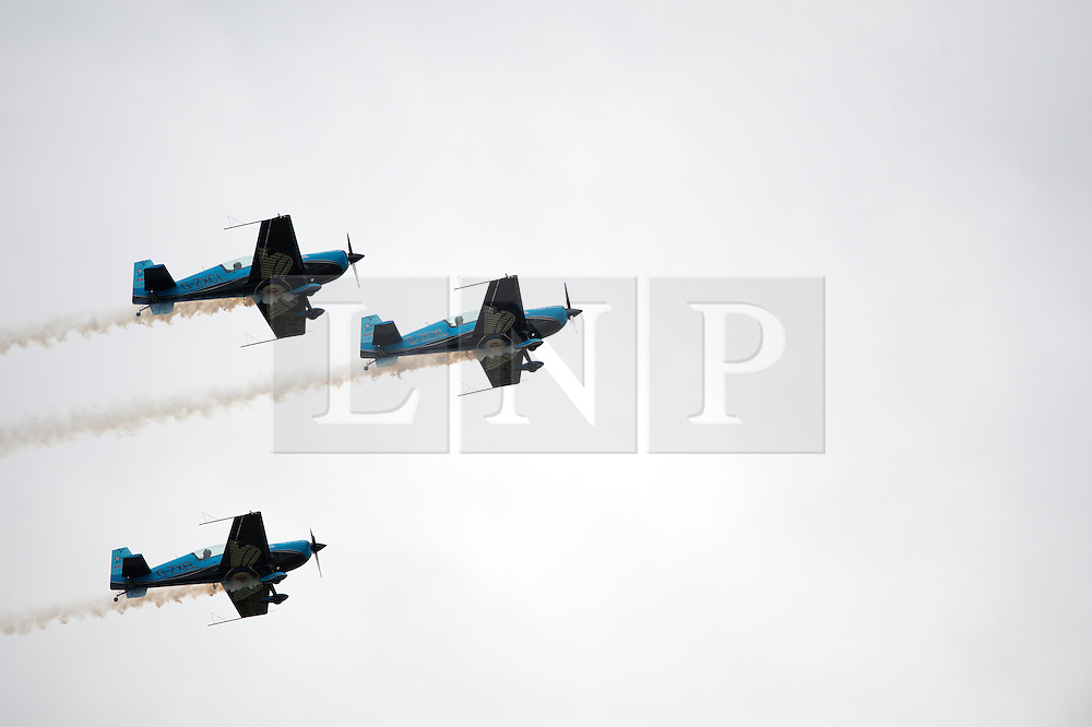© London News Pictures. 09/07/2012. Farnborough, UK. 'The Blades' flying team giving a formation flying demonstration on day one of the Farnborough International Airshow, in Farnborough, Hampshire, UK on July 9, 2012. FIA is a seven-day international trade fair for the aerospace industry which is held every two years at Farnborough Airport . Photo credit: Ben Cawthra/LNP.