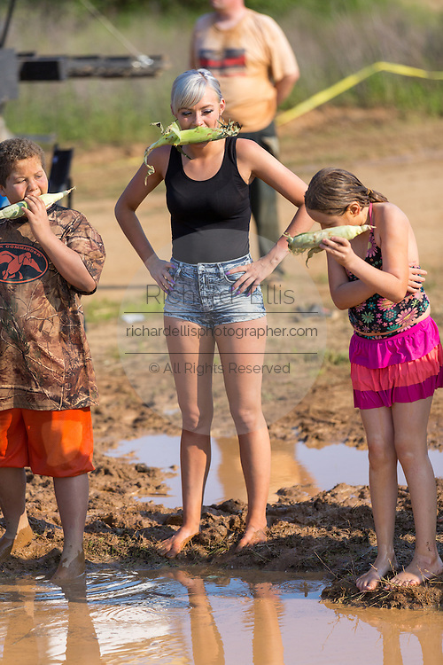 Brittney Austin from the Reality TV show Myrtle Manor prepares to jump into muddy watering hole during a race at the 2015 National Red Neck Championships May 2, 2015 in Augusta, Georgia. Hundreds of people joined in a day of country sport and activities.