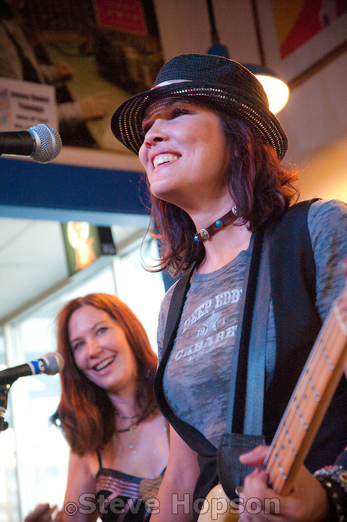 The BlueBonnets perform at Waterloo Records, Austin Texas, June 22, 2010.  The BlueBonnets are Kathy Valentine, Dominique Davalos, Eve Monsees, and Kristy McInnis.  Kathy Valentine (born Kathryn Valentine, January 7, 1959, Austin, Texas) is the bass guitarist for The Go-Go's.  Waterloo Records is an independent record store in Austin Texas.