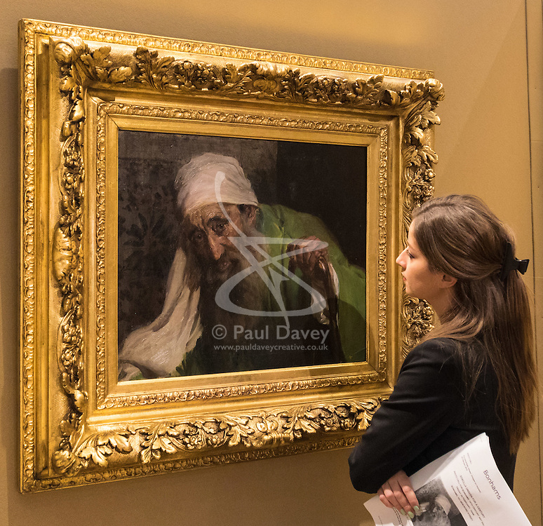 """Bonhams, Mayfair, London, February 26th 2016. A woman admires Joaquin Soralla y Basitda's """"Un Hebreo"""", estimated to fetch between £300,000-500,000 which will be on display until the Bonhams 19th Century Art Sale in Mayfair, London on march 2nd 2016. ///FOR LICENCING CONTACT: paul@pauldaveycreative.co.uk TEL:+44 (0) 7966 016 296 or +44 (0) 20 8969 6875."""