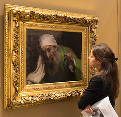 "Bonhams, Mayfair, London, February 26th 2016. A woman admires Joaquin Soralla y Basitda's ""Un Hebreo"", estimated to fetch between £300,000-500,000 which will be on display until the Bonhams 19th Century Art Sale in Mayfair, London on march 2nd 2016. ///FOR LICENCING CONTACT: paul@pauldaveycreative.co.uk TEL:+44 (0) 7966 016 296 or +44 (0) 20 8969 6875."